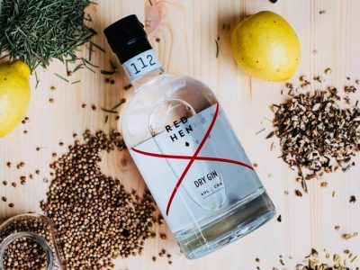 red hen gin surrounded by botanicals